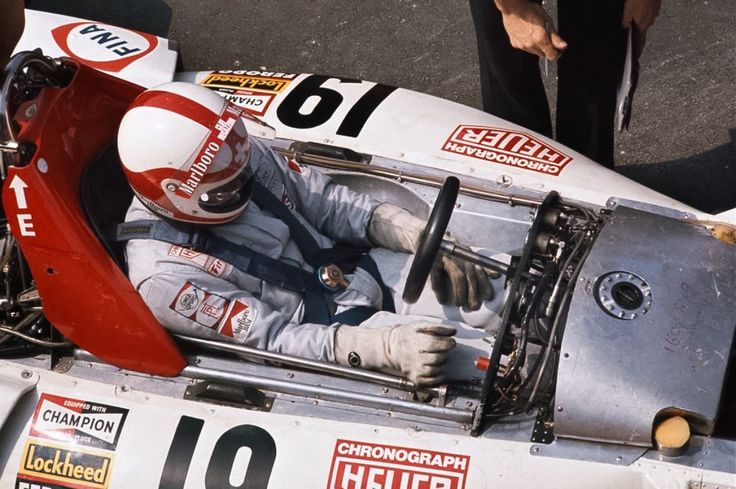 Clay Regazzoni aboard his 1973 BRM P160D: fuel tanks behind him, each side of him & over his legs.