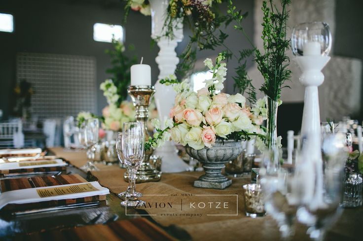Beautiful wooden tables, tiffany chairs, elegant wedding. green and white flowers, hanging flowers, hanging arrangements.Zavion Kotze Events Company -Weddings, Luxury Weddings, Bride to be, Wedding day, bride, wedding flowers, wedding hour, wedding season, decor, décor. roses, gold, white, wedding table