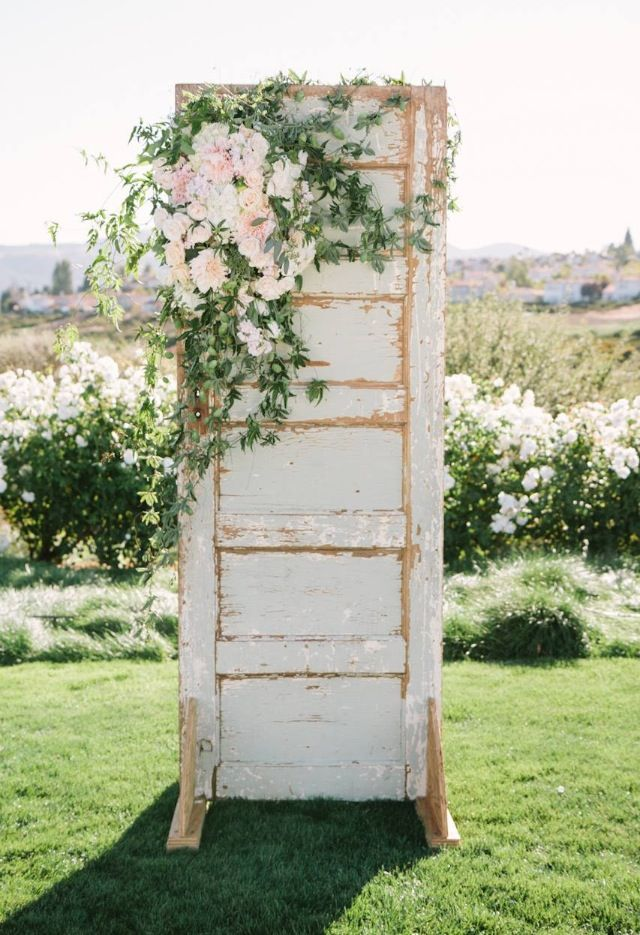 My gf laughs at me for wanting to buy salvaged doors for no reason.  Here's a pretty good reason. Hoping to make this for a bride someday.