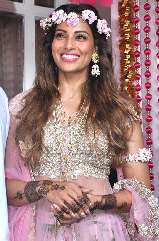 Bipasha Basu in an Anushree Reddy Lehenga with floral jewellery at her Sangeet and Mehendi - bollywood - wedding - bride