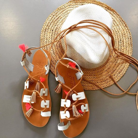 Aelia Favlos leather sandals with beige leather tassel and coral fabric tassel
