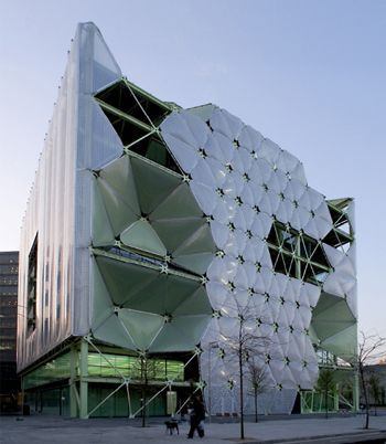 The best building in the world (World Architecture Festival). It is located in Barcelona. On the main facade ETFE has been used by a system of cushions. These are inflation and deflation producing shadows wich achieves significant energy savings.