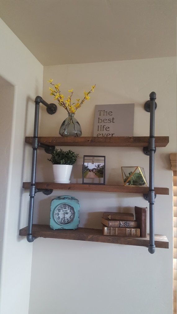 Add an industrial touch to your home decor with our industrial pipe shelves! This piece is solid and is built to last! Made from 3/4 iron pipe. Reclaimed wood plank shelves that measure 2thick × 36 long x 8 deep that have been stained a beautiful color to give that rustic look. The pipe is coated and sealed. Hanging this shelf is easy. Instructions and Hardware for hanging included. Dimensions: 40tall x 36 wide Contact the seller for custom orders! We are more than happy to make you a…