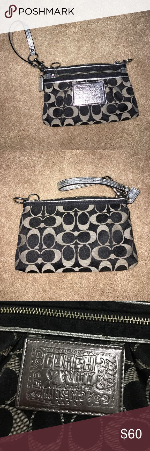 Coach poppy wristlet Silver and black coach poppy wristlet! Has two zippered areas! 8 in wide by 5 in high Coach Bags Clutches & Wristlets