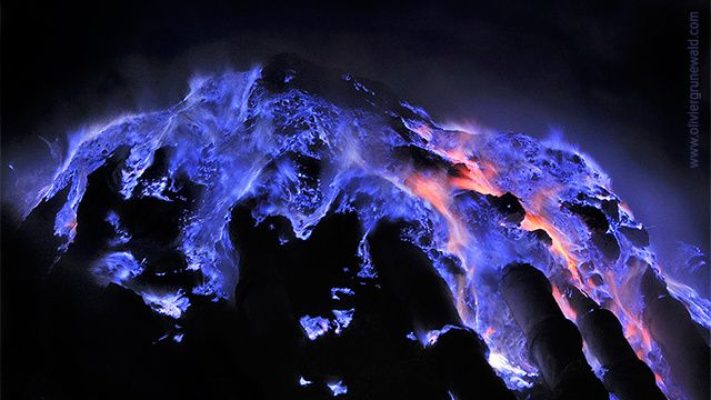 As the light of day recedes, an eerie incandescence appears to rise from the depths of the Kawah Ijen crater in Indonesia. The high-temperature liquid sulphur that flows from an active vent at the edge of the world's largest hydrochloric acid lake flares in blue flames that can reach up to 5 meters (16.5 feet).