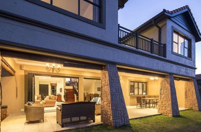 Bona Bali 6 in Zimbali Coastal Resort (Sleeps 8). This immaculately presented holiday home has an incredible feeling of space. The ground floor living areas are intelligently designed with an seamless, open plan living, dining and kitchen area opening out onto a generous,under cover patio with built-in braai - an entertainers dream! #Where2Stay #Zimbali