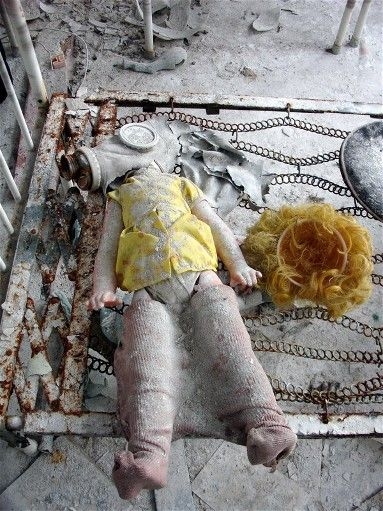 A doll with a gas mask abandoned at a Kindergarten during the Chernobyl disaster.