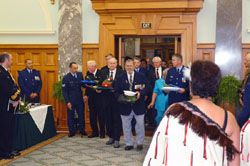The recipients enter the Grand Hall. The first four veterans carry the hats of remembrance. They are: Mr Colin Fraser (ex-RNZAF - Second Word War, J Force, and the Berlin Airlift), Mr Trevor Dean (ex-NZ Army - Malayan Emergency), Mr Brian Sadd (ex-RNZN - Korea, Malayan Emergency, and Suez in 1956), and Retired Superintendent Paul Mears (NZ Police - United Nations Force in Cyprus between July 1965 and July 1966).