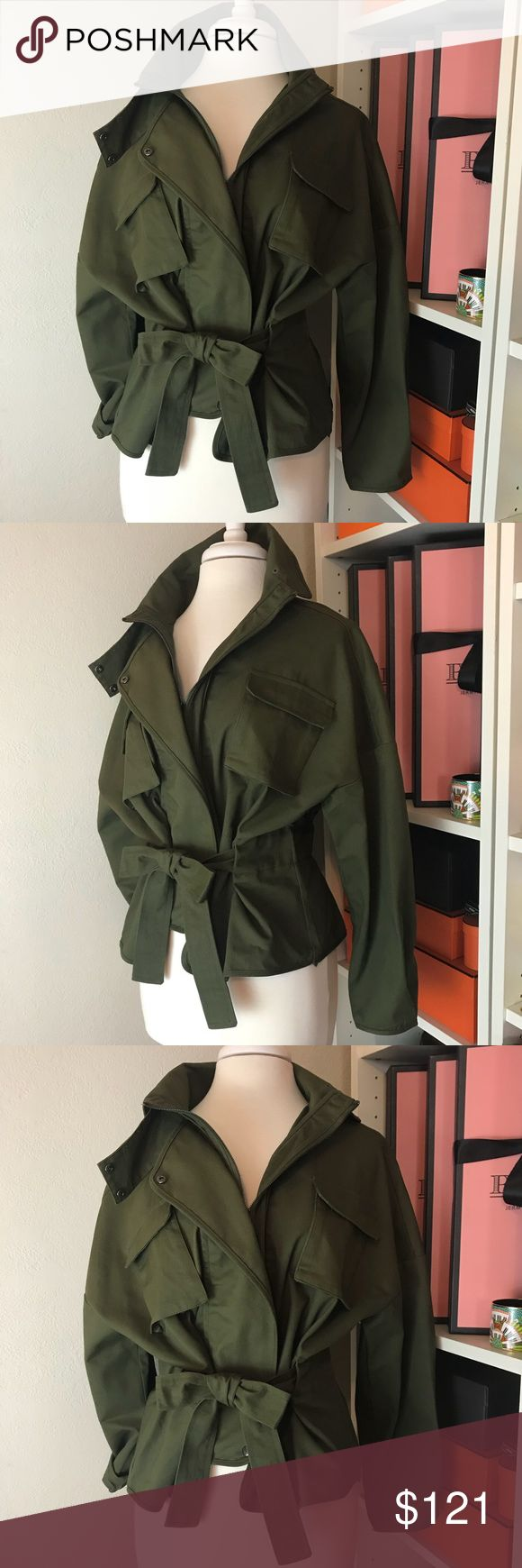 Military Olive Green Cropped Canvas Anorak Jacket A cold-weather update to a classic cotton canvas anorak. Loose fit utility jacket.   Oversized crop style with visually waist cinch look via waist defining belt. Boutique item purchased direct from manufacture.   Sleeves can be worn straight down, rolled up, or pulled up for more relaxed slouchy look.  ❥ All profits are donated to help survivors of domestic violence. Jackets & Coats Utility Jackets