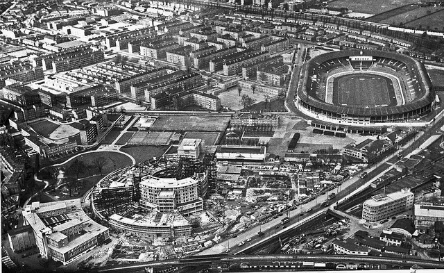 BBC Television Centre under construction. 1948 Olympic stadium in background.