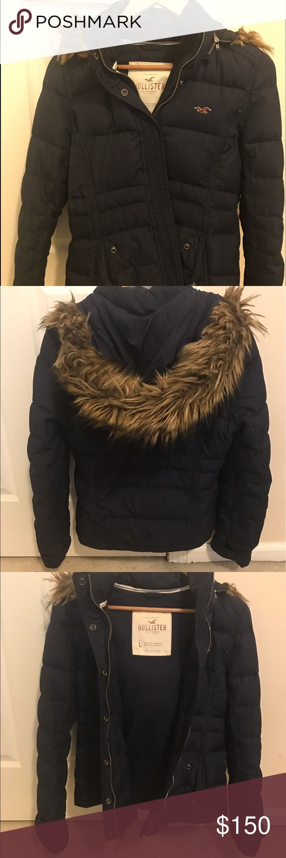 Hollister Jacket Condition: Rarely worn; great condition  Brand/Style: Hollister  Color: Navy blue Description: Warm navy blue jacket, medium size, long enough to cover hips, fur lined hood, zipper and buttons for closing, buttons on pockets   Material: Shell: 100% polyester; fur: 65% waterfowl feather, 35% down/duvet Hollister Jackets & Coats