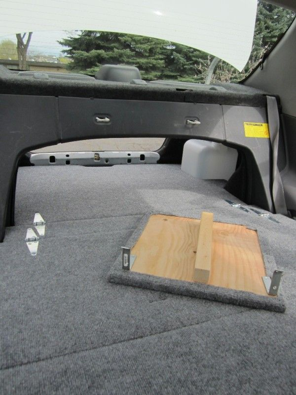toyota echo transformed into stealth car camper 008 600x801 Man Turns his Toyota Echo into Stealthy Micro RV for Car Camping