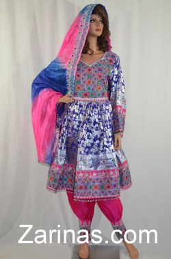 Karida Formal Afghan Dress. Gorgeous, luxurious Afghan dress, decorated with a beautiful embroidered pattern. Decorated with elegant mirrors and beads trimming the hemline and sleeves. Comes with an equally beautiful, tie-dye, embroidered scarf, and matching pink pants. Be flawless in this amazing, formal Afghan dress!