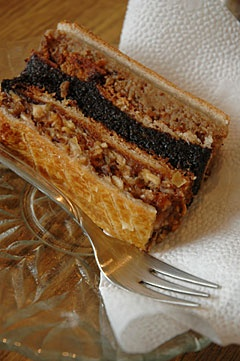 'Flódni' is a typical Hungarian Jewish cake. It is similar to the 'zserbó'. The main difference is the number of the layers or stripes. Zserbó has three meanwhile flódni has five. We put poppy seeds, walnut, apple and plum jam between the layers of dough.
