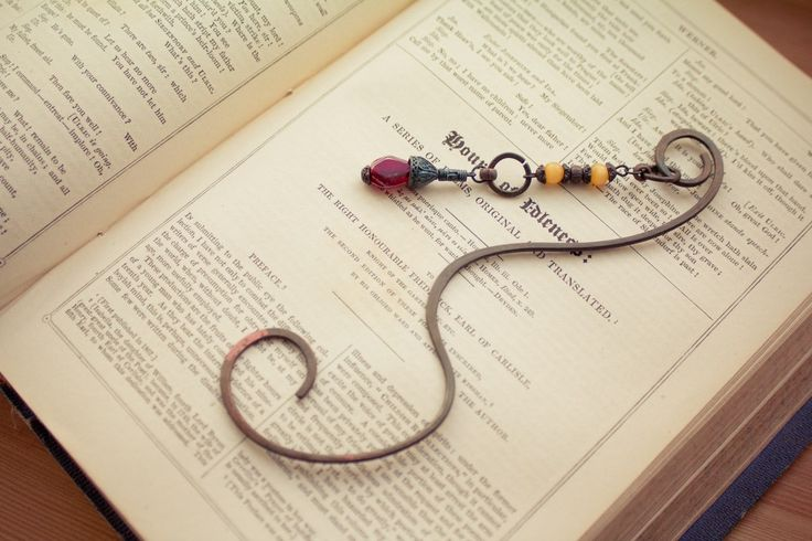 Hand-crafted copper bookmarks look the best with old, yellow-paged books.