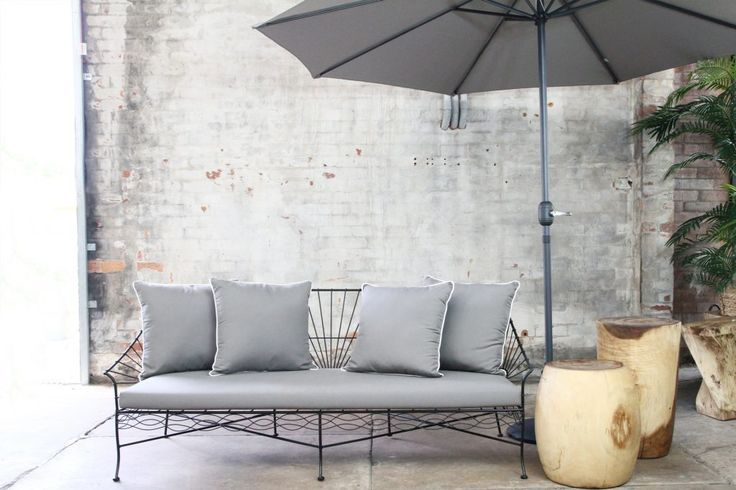 Wrought iron daybed with sunbrella