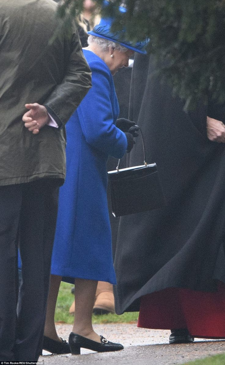 The Queen, who wore a royal blue coat and matching hat, was seen making her way to the church this morning