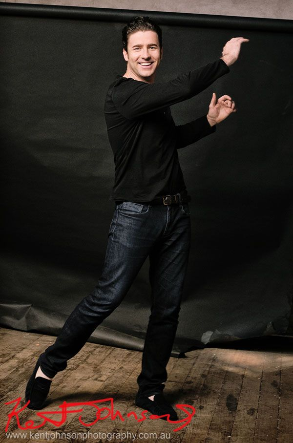 Male Modelling Portfolio, Colour against black back drop, action shot, jeans and Tee shirt
