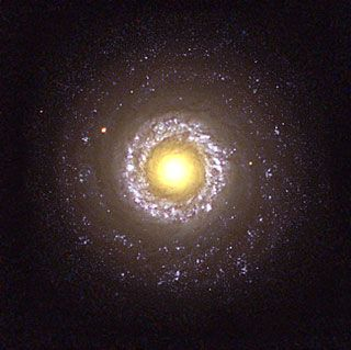 1998. What may first appear as a sunny side up egg is actually NASA/ESA Hubble Space Telescope's face-on snapshot of the small spiral galaxy NGC 7742. But NGC 7742 is not a run-of-the-mill spiral galaxy. In fact, this spiral is known to be a Seyfert 2 active galaxy, a type of galaxy that is probably powered by a black hole residing in its core.