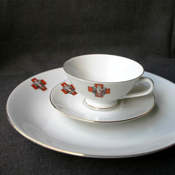 DESTOCK !!! Was 29.95 USD and now only 19.95 USD :-))   This listing is for a lovely vintage Red Cross porcelain cup with its matching saucer and dessert plate.  Youll get the three (3) pieces pictured, each decorated with the Red Cross emblem for blood donation.  Excellent/perfect vintage condition as it was apparently never used. Comes in original box.  Cup meas. approx. 80mm diameter on top x 40mm high. Saucer and dessert plate respectively having a diameter of 108 and 190mm.   And ...