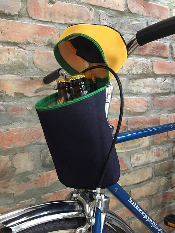 This bag you can attach to your handlebar and stem with double sided velcro straps. What CAN it carry?! It fits a standard water bottle, beverage cans/bottles (beer of cousre), your phone, keys, wallet, snacks....use your imagination. Measurements: ►Length: 15 cm = 6 ►Width:8 cm = 3