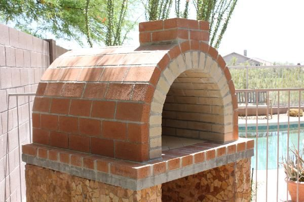 One of our first ovens.. the Louis Oven is a full firebrick taller than our current Mattone Barile Grande Ovens.  The Travertine on the Pizza Oven Base really makes this DIY Pizza Oven unique!  BrickWoodOvens.com