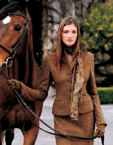 Why is she walking this horse in a business suit? It's not like she's going for a ride, she's wearing a skirt. Ok, love the brown color and the textures.
