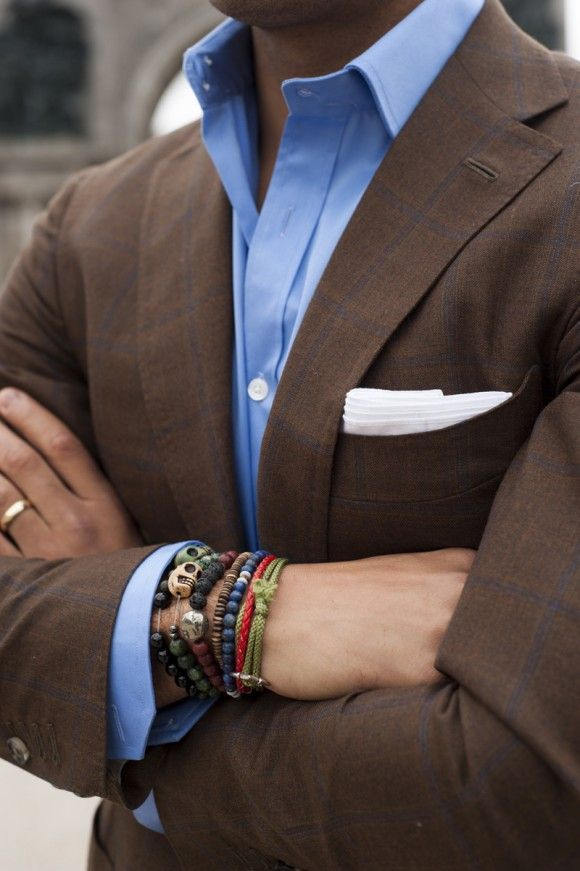 Shop this look for $208:  http://lookastic.com/men/looks/blue-dress-shirt-and-brown-blazer-and-white-pocket-square/1810  — Blue Dress Shirt  — Brown Plaid Blazer  — White Pocket Square