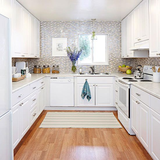 The U-shape layout is practical, while the glass tile backsplash adds pretty to this hardworking space.