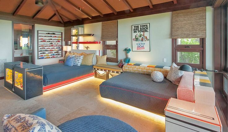Magnificent Estate in Kailua, Hawaii | This lively kids' room on Oahu's exclusive Kailua Beach features underlit beds, an aquarium, and racks for toys.