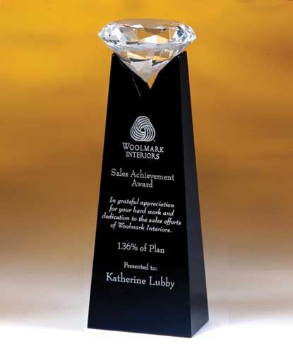 "The Rising Diamond Crystal Award measures 9"" in height and features an optically clear crystal diamond. Your custom engraving will be deep etched and filled with silver fill. Truly a magnificent award worthy of the greatest achievements. This award ships in a premium quality presentation box.    http://www.edco.com/cat/optic-crystal-awards"