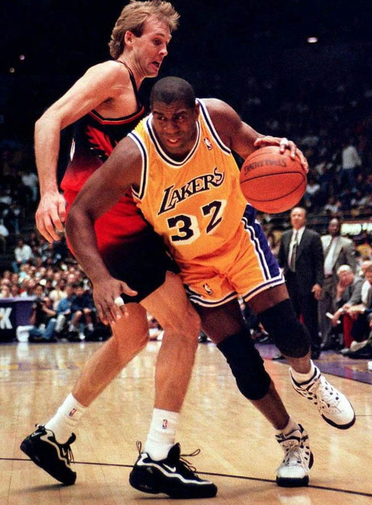 Magic Johnson drives past Craig Ehlo