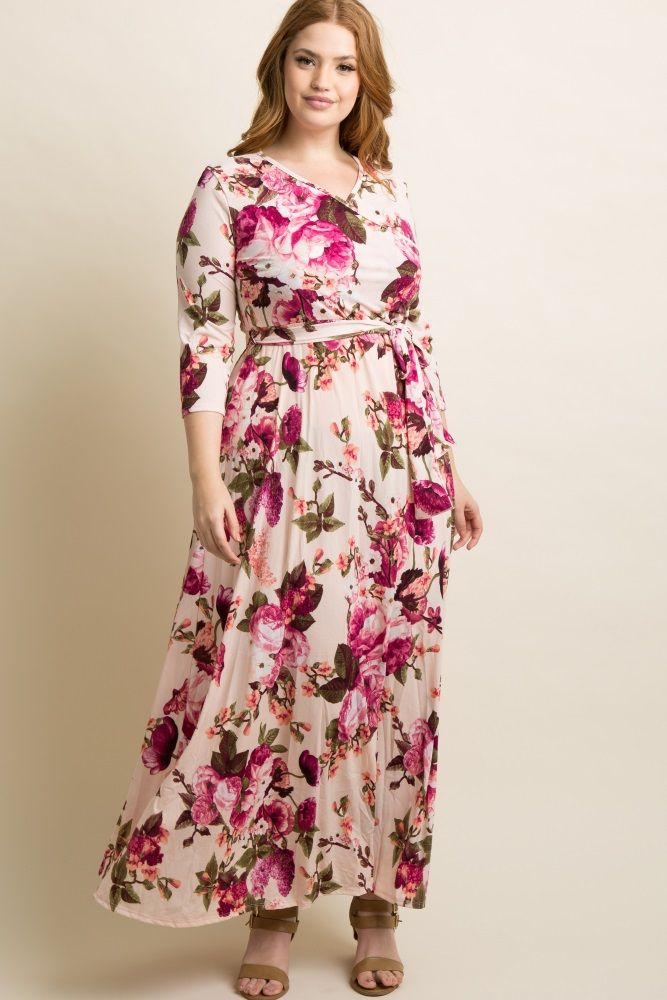 a4b8d8a1f49 A 3 4 sleeve floral printed plus maxi dress. V-neckline. Sash tie.