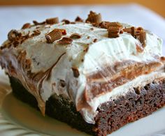 Brownie Refrigerator Cake | With layers of brownie, chocolate pudding, cream cheese, whipped topping, and fudge, this dessert is absolutely amazing.