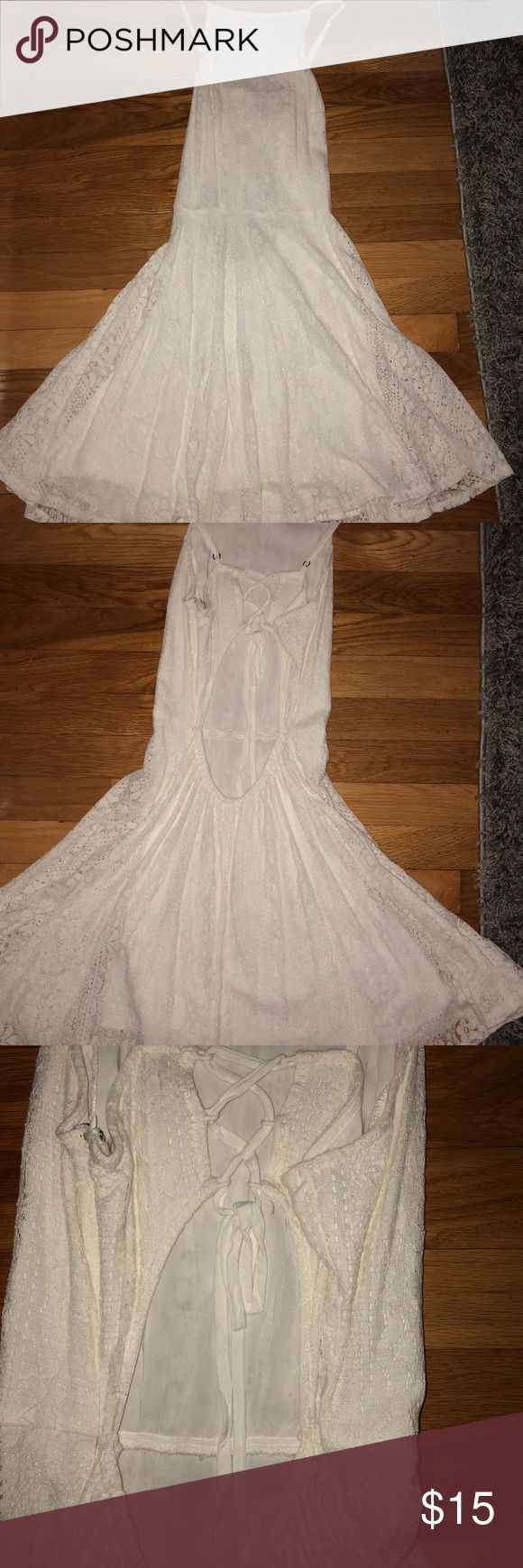 Hollister Dress Off-white/cream lace Hollister dress in size women's large. Runs small - I am typically a size medium and this fit me perfectly. Double-lined. Top is form-fitting and bottom is loose and flows. Back is criss-crossed and open. Only worn once and in perfect condition. Hollister Dresses