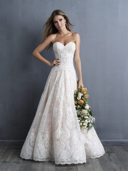ca320373595 Lace intricately covers this strapless gown