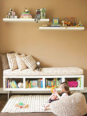 Love this seating for a kids play room...especially the fact that the toys and books are not placed very high so the kid can access without asking for assistance