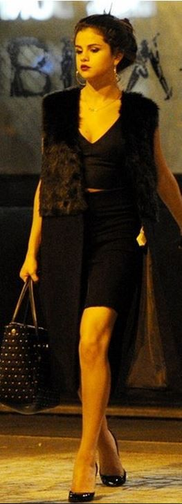 Who made  Selena Gomez's black studded handbag, coat, and cropped top?