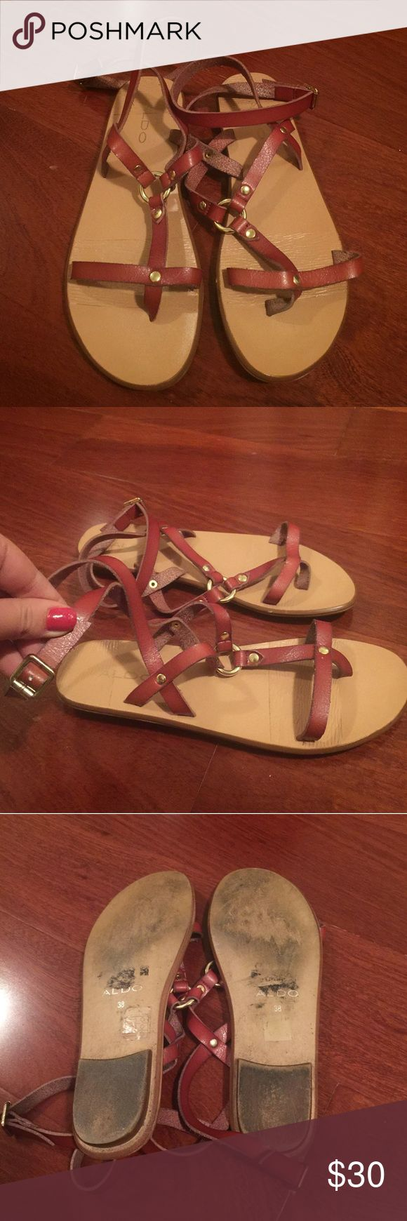 Aldo Ankle Wrap Sandals Pre-Owned with noticeable wear on bottom. Brown ankle wrap sandals with gold hardware by Aldo. Size 38 / 7.5. Aldo Shoes Sandals