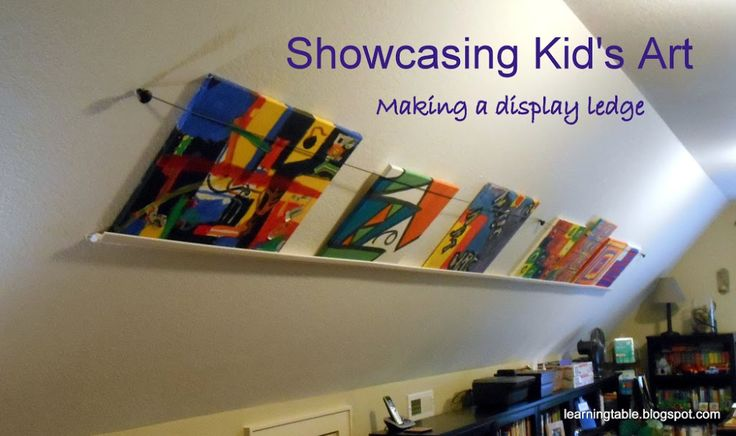 SHOWCASING KID'S ART Build and inexpensive DIY display ledge for all those fab paintings and creations. |mylearningtable.com