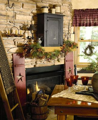 homey ideas fireplace designs. love the wooden star shutters by fireplace black cupboard on  stone wall 169 best PRIMITIVE FIREPLACES images Pinterest Primitive