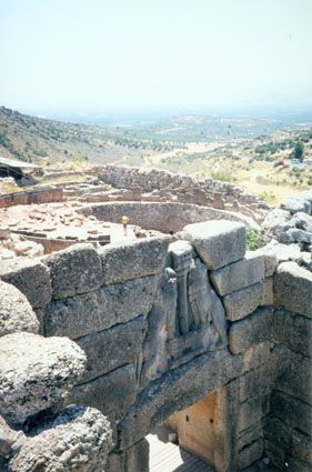 A view of the famous Lion Gate at Mycenae (built 1250 BC). Beyond the gate is Grave Circle A that dates to 1550 BC. These graves yielded over 15kg of golden artefacts that are now on display in the Athens National Museum.
