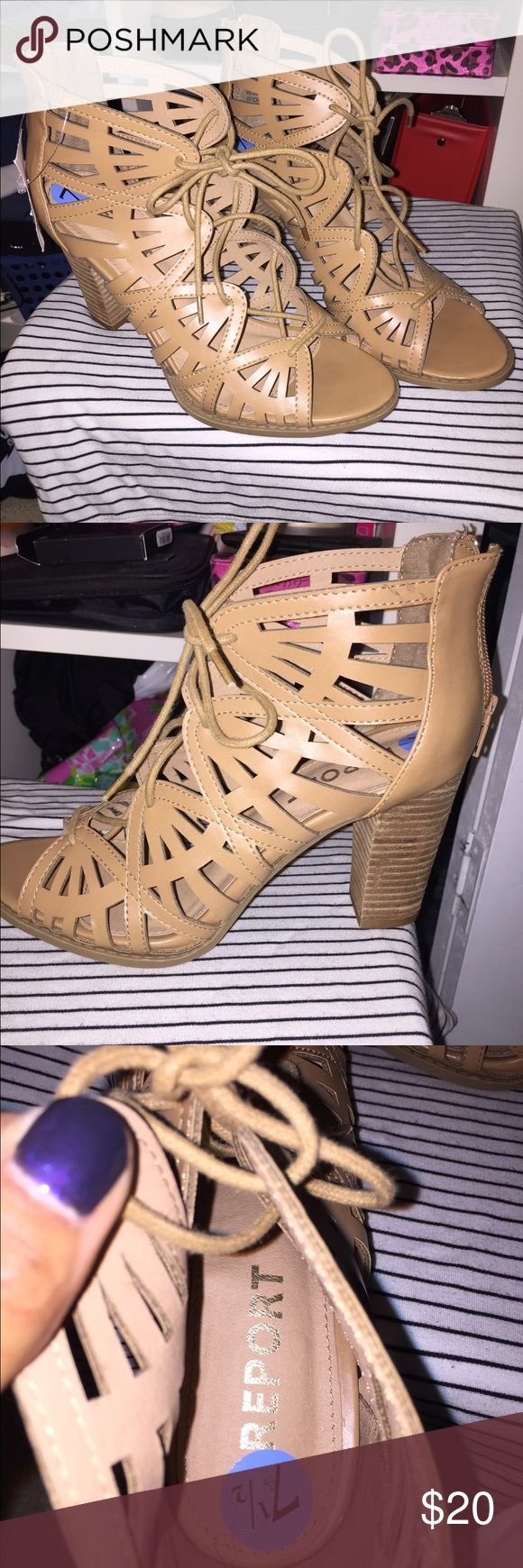 Brown heeled sandals There cute lace up brown sandals great for the summer time. Would be cute with a dress or some jeans and nice shirt. NWT never worn, I bought them, but to big for me. Report Shoes Sandals