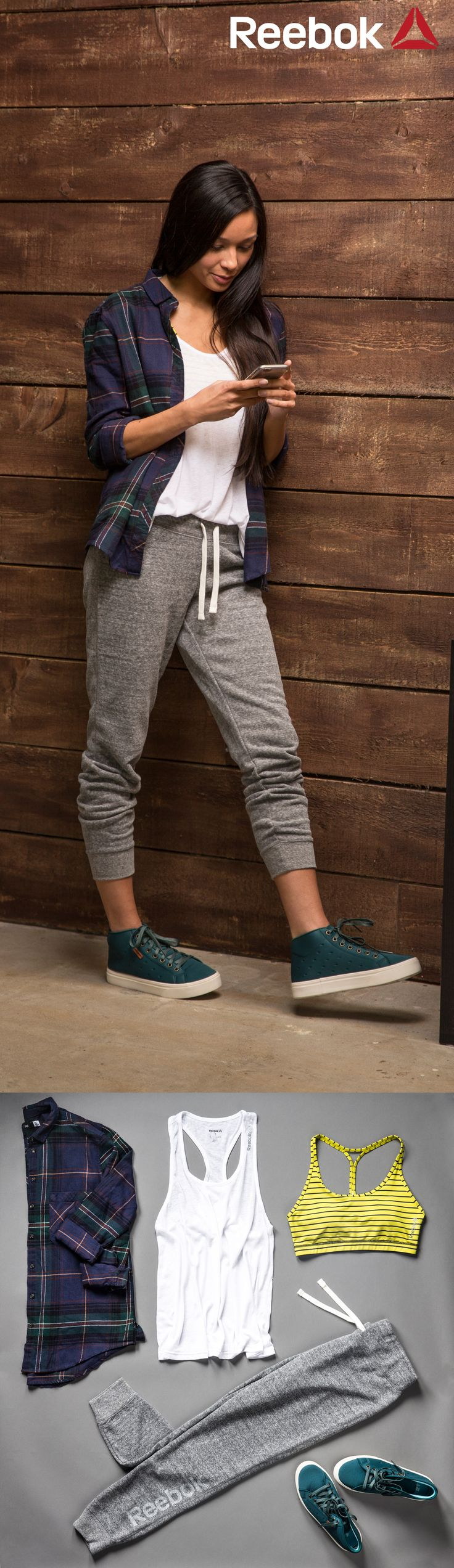 Channel cozy weekend vibes by pairing your favorite fitness apparel with a flannel shirt and high top Skyscape sneakers. These grey Reebok jogger pants are perfect for rest day!