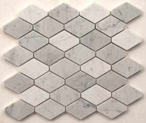 Elongated Carrara mosaic with a mix of textured & polished pieces. Also available in travertine. #mosaic #stone #natural #polished #texture