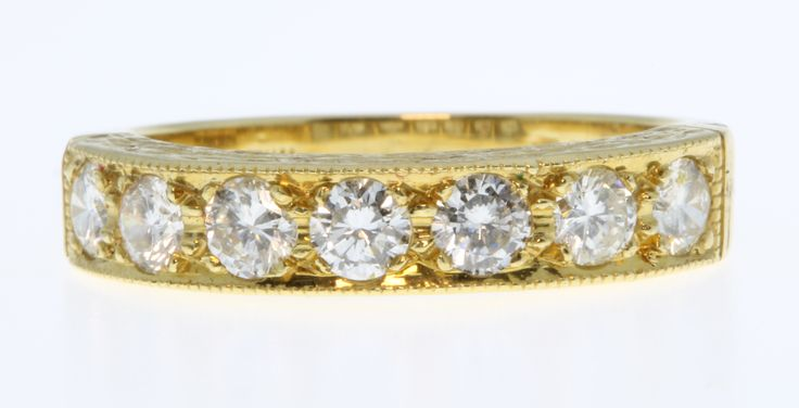 Lot 692, An 18ct yellow gold 7 stone diamond ring, approx 1ct, size O 1/2, est  £500-700