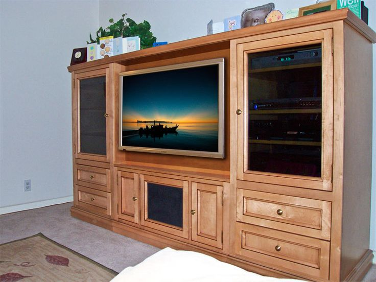 Natural Birch Low-Profile Wall Unit For Flat Panel Hdtv - I like the dark glass and clean lines.