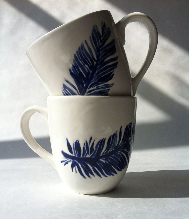 Set of 2 blue indigo, navy blue and white feather ceramic coffee, tea, mugs, cups by Jessica Howard
