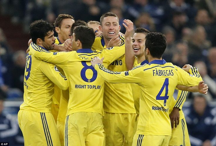 Chelsea celebrate on their way to an emphatic victory over Schalke which takes them into the final 16