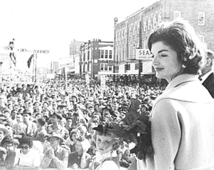 October 1959: Jackie Kennedy looking out on the scene at the Int'l Rice Festival in Crowley, LA, where JFK addressed a crowd of more than 130,000. Victoria Reggie Kennedy's parents was there with the JFK'S .♥❃❋✽✾❀❃ ♥     http://en.wikipedia.org/wiki/Jacqueline_Kennedy_Onassis